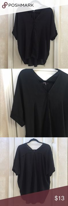 Black V-Neck Top Black top with slight hi-low hem and cuffed sleeves. Love Culture Tops