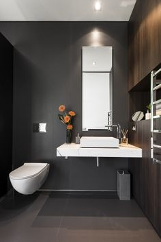 Architecture: White Modern Toilet White Sink Bathroom Faucet Single Hole Mirror Bathroom Waste Bin Wooden Wall And Concrete Floor Heated Towel Rail: Family House - Timeless Luxury House Gathering Waterside Panoramas Best Bathroom Designs, Contemporary Bathroom Designs, Contemporary Interior Design, Modern Bathroom, Modern Interior, Bathroom Ideas, Bathroom Renovations, Small Half Bathrooms, Small Bathroom