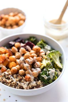 These nourishing Quinoa Buddha Bowls are served with paprika roasted butternut squash, garlic roasted beets, lemony kale and broccoli, paprika-spiced chickpeas and served with a creamy tahini-miso dressing! Naturally gluten-free, vegetarian, vegan and great for meal prep!