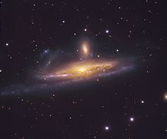 Located over 50 million light years away, the large, distorted spiral NGC 1532 is seen locked in a gravitational struggle with dwarf galaxy ...