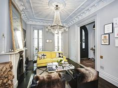 Jenna Lyon's house (for sale!)...impeccably decorated. love the yellow + grey + chandelier + fur...