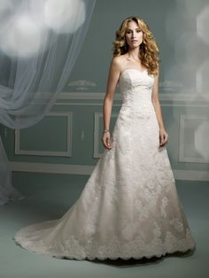 Strapless satin and lace A-line gown with sweetheart neckline, bodice features re-embroidered lace appliqué trailing down skirt to matching lace hemline with scalloped edging, chapel length train, detachable spaghetti and halter straps included. Sizes:2 – 20, 18W – 26W Wedding Dress Styles, Designer Wedding Dresses, Wedding Dresses Photos, Perfect Wedding Dress, Wedding Fun, Lace Wedding, Wedding Stuff, Lace Ball Gowns, Bridal Gowns