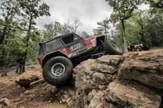 Genright red YJ Jeep offroading in Arkansas