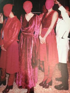 Martin Margiela, Winter 1995    Silhouettes of black and dark colours evolve, as the women pass, into outfits of combined pinks and fuschias.