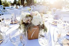 Beautiful floral centerpieces and table decor on the reception tables during a vineyard wedding at Mount Palomar Winery. It's hard to find a more beautiful spot for a wedding then Temecula Wine Country. #mountpalomarwinery