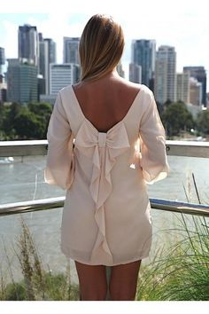 """This item is currently out of stock. Please """"Ask a Question"""" above or contact UsTrendy to be notified via email with updates for back in stock.     Ultra sweet bow back detail dress  Featuring a slit sleeves detail  Bow back ruffle detail  Flowy fit  Fully lined except sleeves  Chiffon-feel fabric  Elasticated sleeve cuff Model wears size XS  Model height: 165cm without heels  Length of size S dress from shoulder to hem 79cm  Looks perfect worn with delicate gold jewelry"""