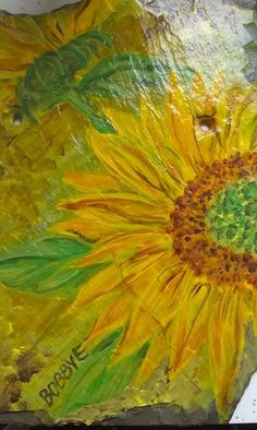 Sunflower painted on a slate roof tile