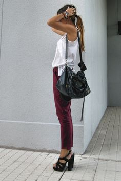 Burgundy Pants. WhiteTop. Black shoes. Black handbag.