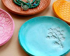 Use texture plates, sand/or stamps, sculpt (or regular clay?), lay on paper bowl for mold-- Clay Jewelry Dish