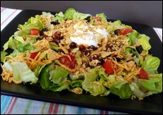Taco-tastic: 2 cups romaine lettuce, chopped, 1/2 package (4.5 oz)  Boca Chili, 1/4 tomato, diced, 1 oz. FF Shredded Cheddar Cheese, 2 Tbsp FF Sour Cream, 1/4 cup chunky salsa, 2 black olives, sliced, 6 Guiltless Gourmet Tortilla Chips, crushed