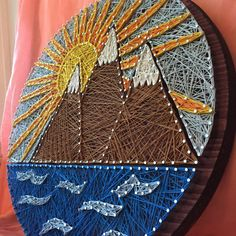 This listing is for a string art mountain sunset design on a round black cherry stained 18 pine background. Ready to hang on the wall.
