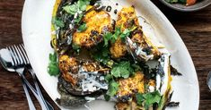 Spicy Roasted Cauliflower with Tahini Recipe - Saveur - Whole cauliflower is quartered and roasted with paprika, turmeric, and jalapeño in this wintry side dish. Spicy Roasted Cauliflower, Cauliflower Recipes, Veggie Recipes, Vegetarian Recipes, Cooking Recipes, Healthy Recipes, Saveur Recipes, Veggie Meals, Healthy Treats