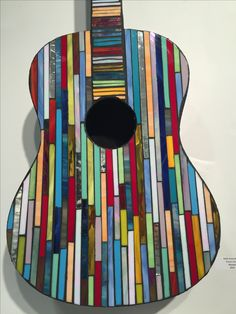 Another mosaic stained glass art piece on an old guitar.