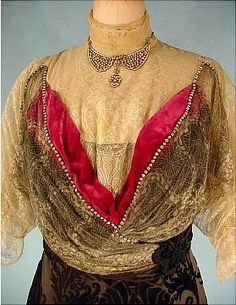 "c. 1912 DUNLEVY Cut Velvet Trained Evening Gown of Deep Eggplant with Fuschia Velvet and Ecru Lace with Rhinestones. Dark Eggplant color (purplish-brown) cut velvet trained skirt which opens at lower front to reveal a splash of deep rose velvet covered in ecru lace. Bodice is mostly covered with spiderweb gold metallic and ecru lace with the overlay of low ""v"" neck velvet covered with the same laces... trimmed with rhinestones. Detail"
