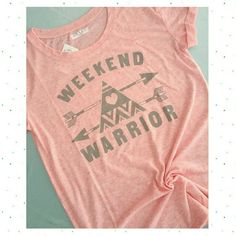 "PM Editor Pick! 2x HP Weekend Warrior Tee Pink  WOW!! PM Editor Pick 1/11! Host Pick by @houseofposh! 1/8  Host Pick by @tammyleetucker! 1/10   5 star rated! Last 1! Size XL available.  Super soft & cozy tee in pale pink speckly cotton  with gray ""Weekend Warrior"" graphic print, cuffed short-sleeves, long length- not quite tunic length. Semi-sheer (see pic 3) wear a cami or fun bralette underneath! NO TRADES OR PP. Tops Tees - Short Sleeve"
