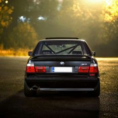 BMW E34 M5 black  i have one with a roll cage   6 cylinder i loved was better on gas   v6 are better but good on gas GMC and DODGE cars trucks suvs in short future!