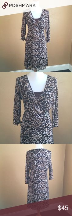 BCBGMAXAZRIA Leopard Dress with Sleeves Leopard dress  with sleeves 💯 % Nylon 💯 % polyester Lining use once like New   No tags still in Excellent Condition no issues no stains or tears . Hand wash cold with like colors only non Chlorine bleach lay flat to Dry do not steam. BCBGMaxAzria Dresses