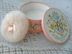 Avon talcum powder with the big puff. I had lots of talcs and powders from Avon.