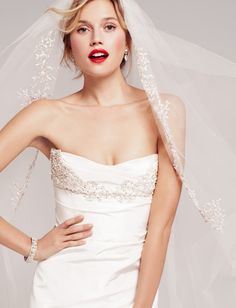 love the red lips! ads a pop to the traditional white.