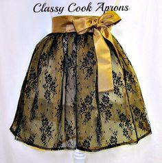 The trend is SHEER--Ultra feminine lace is one of the hottest trends this season. This apron a vision in double layers of Midnight Black Floral Lace over sheer shimmering Antique Gold Organza. It features scalloped edges in the back (so you're a vision, coming-and-going) and for a touch of panache, we added a matching Antique Gold Taffeta waist and sash with extra long ties, for a big beautiful back, side or front bow. OMG! Glamor Girl Gorgeous!