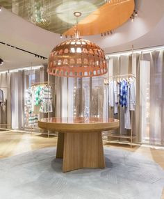 Missoni's flagship store with parquet flooring, multicolored marble walls, and slatted timber screens