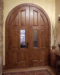 Trustile TS8010 radius-top common arch pair in knotty alder with custom glass inserts