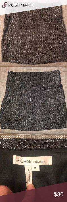 BCBG Metallic Skirt! Super cute metallic skirt. Wore once! Excellent condition. Elastic waistband.  Used the cover photo to show how it fits! Note- Skirt is a black/grey color! BCBG Skirts