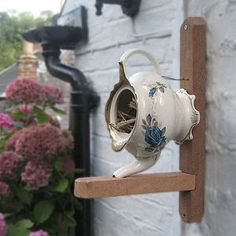 Teapot bird house. Charming...but since the entrance is so wide, it needs to be faced in a protected  area.