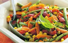 Roasted Vegetables with Basil: Roasting brings out the best of veggies in a side dish sized for a crowd.