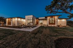 Experience a stunning contemporary home with native limestone, old world stucco and ipe wood accents! Home Depot Front Door, Double Doors Exterior, Custom Home Designs, Custom Built Homes, Custom Home Builders, Home Photo, Design Firms, Luxury Homes, Building A House