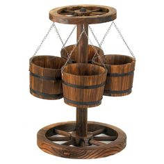 Rustic planter creates an instant oasis with a little country charm! Four buckets hold a quartet of your loveliest plants suspended from a realistic wagon wheel