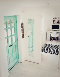 Turquoise door and white floor interiors on www.breathehappiness.co.uk