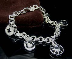 """925 Sterling Silver Charm Bracelet with 5 different charms. This is the best Christmas gift to bring all the charm and luck, and make you or your loved one happy.   There is only one in the stuck at this time.   Hurry and get it, lower price than this won't be again. This is a Christmas special.      SIZE: The bracelet is 7.9"""" long, each charm is approximately 14x14mm big, and overall it weights 23 gram.  MATERIAL: stamped 925 sterling silver"""