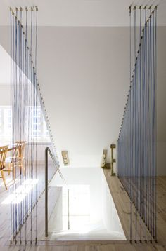 Instead of building a new wall, turn a barrier into a piece of art with in-line stings stretched floor-to-ceiling
