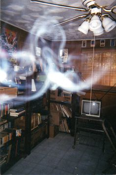 Picture of a ghost & orbs my best friend took in a room in his house just after he bought it. Way cool!