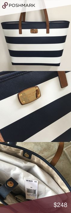 """✨MICHAEL KORS Jet Set Tote✨ % AUTHENTIC MICHAEL KORS Jet Set medium tote.  Leather bag with navy and white stripes and brown leather handles.  Gold logo plate.  Snap top closure.  Slip pocket on back side.  Interior has 4 slip pockets and one zip pocket.  Measures approx 19"""" across the top and tapers to 14"""" across the bottom, 12"""" high and 4.5"""" deep.  Perfect bag to make a statement!  Brand new with tags. Michael Kors Bags Totes"""