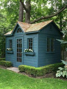 Blue roof cabin diy trellis over the garage door garden for Quick garden buildings