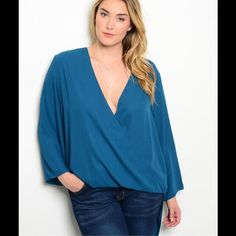 Teal Plus Top This gorgeous top features cross front panel shorter in front with drape back. Long sleeves. Front panel measures 28 inches. Back panel measures 38 inches long, 100% Polyester. (This closet does not trade or use PayPal) Hot Ginger Tops Blouses