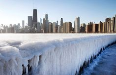 Winter storm freezes much of US Ice builds up along North Avenue Pier in Chicago, January 7, 2015.