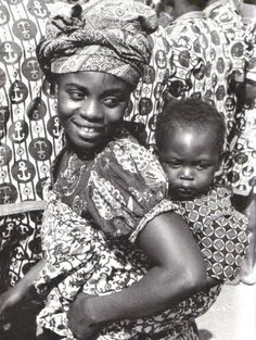 A Fante mother carrying her child in a  wrapper on her back.  Photograph by Doran H. Ross  Legu, Ghana, 1976