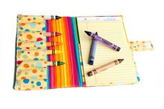 Crayon and notebook folder - good for the car or church. She has tons of other great project ideas here.