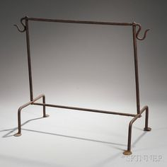 Wrought Iron Hearth Tool StandWrought Iron Hearth Tool Stand, America, late 18th/early 19th century, the rectangular frame with a hook on either end of top bar, on four penny feet, ht. 23 1/4, wd. 28 1/2, dp. 14 in.