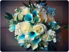 Created by Fleurt Floral Art (yes, the callas are dyed!)