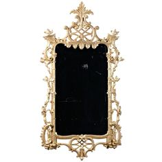 A Chippendale giltwood mirror in the Rococco manner with acanthus and latticework crest over a lambriquin upper liner with vertical columns on either side having interlaced foliate vines on rocaille plinths above a carved apron. The overall design of the mirror hints at an Irish origin, circa 1760. LENGTH: 	30 in. (76 cm)  DEPTH: 	3 in. (8 cm)  HEIGHT: 	4 ft. 10 in. (147 cm) -  G. Sergeant Antiques L.L.C., Woodbury, CT