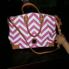 Dooney & Bourke chevron bag Canvas chevron leather Dooney&Bourke handbag. Medium in size. Signs of use on inside, flawless on outside. Pink and white chevron design with tan straps. Red interior. The long strap is a shoulder strap, not long enough to be crossbody unless you're really skinny or short. Owner before me was heavy smoker, so still smells a bit, but I've been trying to get rid of it. Dooney & Bourke Bags Satchels