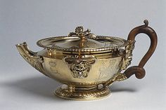 """1813-1814 British Teapot (part of a set) at the Metropolitan Museum of Art, New York - From the curators' comments: """"The arms of Anne McDonnell, countess of Antrim, are engraved on each piece. The teapot is fashioned in the form of an ancient Greek or Roman oil lamp."""""""