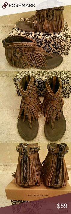 Naughty Monkey western fringe sandals They make you go ooooooh! color is called charcoal but it is more of a brown with undertones of black; pewter chain at the cuff; pewter concha on the side; lots of fringe; all leather; zips up the back; nicely padded sole; just all around great shoes; new with tags - in box ; Naughty Monkey brand by Olivia Wilde; size 7 (box) top to the box has been lost naughty monkey Shoes Flats & Loafers