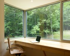 If this was my office I don't think I'd get anything done. I'd be to busy looking out these awesome windows.