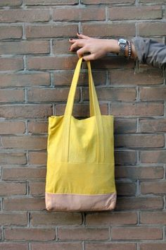 Imke De Jong - Hello Yellow; cotton tote bag with a leather bottom | hand dyed heavy quality cotton | prototype
