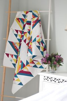 Retro Metro Quilt PDF Pattern, instant download. Modern unique quilt pattern using a fun combination of half square triangles and roman stripes.